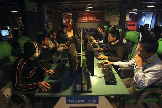 In this Monday, Jan. 30, 2012 photo, Vietnamese youngsters play online games at Cyzone, one of the biggest game centers in Hanoi. Vietnam's graying Communist Party is all about control: It censors all media, squashes protests and imprisons those who dare to speak out against its one-party system. Censors still review books, films and foreign newspapers for sensitive content while bureaucrats try to curb, with varying success, everything from online gaming to motorbike racing. But today, as iPhone shops rub shoulders with Buddhist pagodas, cultural authorities are finding it increasingly difficult to promote their unified sense of Vietnamese culture and identity, especially among the country's youth. (AP Photo/Na Son Nguyen)