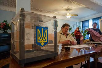 Election commission workers prepare for a referendum at a polling station in Orlinoye village near Sevastopol, Crimea, Ukraine, Friday. Crimea plans to hold a referendum on Sunday that will ask residents if they want the territory to become part of Russia. Ukraine's government and Western nations have denounced the referendum as illegitimate and warned Russia against trying to annex Crimea.