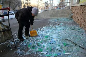 A worker sweeps up shattered glass from a store's broken windows in Chelyabinsk, Russia. A meteor that scientists estimate weighed 10 tons streaked at supersonic speed and exploded over Russia's Ural Mountains on Friday, setting off blasts that shattered glass and brought down walls, injuring hundreds.