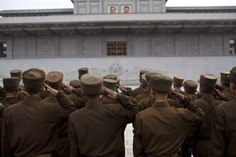North Korean soldiers salute in front of Kumsusan Palace of the Sun, the mausoleum where the bodies of the late leaders Kim Il Sung and Kim Jong Il lie embalmed, in Pyongyang on Thursday, April 25, 2013. North Korea on Thursday marked the 81st anniversary of the founding of its military, which began as an anti-Japanese militia and now has an estimated 1.2-million troops. (AP Photo/David Guttenfelder)