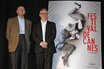 President of the Cannes Film Festival Gilles Jacob, left, and artistic Director Thierry Fremaux pose in front of the Cannes International Film Festival poster for the upcoming 66th edition featuring U.S. actors Paul Newman and Joanne Woodward during a press conference to announce this years line up in Paris, Thursday April 18, 2013. The festival will run from May 15 to May 26, 2013. (AP Photo/Francois Mori)