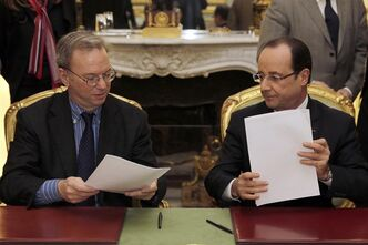 This Friday, Feb. 1, 2013, file photo shows Google CEO, Eric Schmidt, left, and French President Francois Hollande signing an agreement at the Elysee Palace in Paris. (AP Photo/Philippe Wojazer, Pool-File)