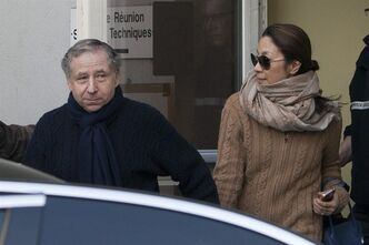 President of the Federation Internationale de l'Automobile, F.I.A., Jean Todt, left, and his companion, Michelle Yeoh, leave the hospital where former seven-time Formula One champion Michael Schumacher is being treated after sustaining a head injury during a ski accident, in Grenoble, France, Wednesday, Jan. 1, 2014. Schumacher's condition was stable but still critical as he remained unconscious, his manager said Wednesday. (AP Photo/Thibault Camus)