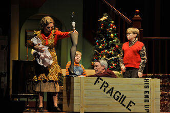 The Parker family, played by (from left) Sharon Bajer, Mackenzie Wojcik, Gordon Tanner and Ben McIntyre-Ridd, uncrate a major prize.