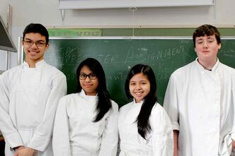 (Left to right) Edward Sotto, Kristina Racraquin, Roshaira Salvador, and Montgomery Marek make up Tec Voc's team, Vesper Hornets, which competed in the Localvore Iron Chef Cook-off on Feb. 7. The team took second place in Tier 1 of the competition, the category for culinary arts and commercial cooking.