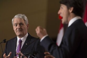 Marc Garneau, left, and Justin Trudeau take part in the the Liberal leadership debate in Mississauga, Ont., on Saturday, February 16, 2013. THE CANADIAN PRESS/Chris Young
