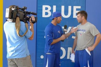 J.P Arencibia (left) plays TV interviewer with fellow catcher Josh Thole on Friday Feb. 22, 2013 at the Blue Jays' spring training in Dunedin, Fl. THE CANADIAN PRESS/Neil Davidson