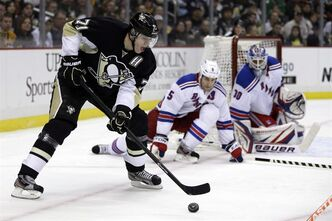Pittsburgh Penguins center Evgeni Malkin (71) looks to get a shot off in front of New York Rangers defenceman Dan Girardi (5) and goalie Henrik Lundqvist (30) during the second period of an NHL hockey game in Pittsburgh on Friday, April 5, 2013. New teams and new alignments will make the NHL's Eastern Conference a mystery this season.THE CANADIAN PRESS/AP/Gene J. Puskar