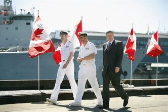 Prime Minister Stephen Harper is escorted by Vice-Admiral Robertson and Rear-Admiral Girouard prior to making an announcement of the construction of up to eight Polar Class 5 Arctic Offshore Patrol Ships at CFB Esquimalt in Victoria, B.C., on July 9, 2007. A new report by two independent think-tanks recommends the Harper government abandon its pet project to construct Arctic patrol ships for the navy. THE CANADIAN PRESS/Deddeda Stemler