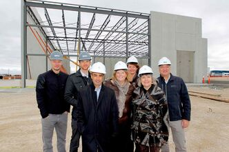 (Left) Bird Construction's Nathan Wiebe and Paul Bergman, Shindico Realty manager Robert Scaletta, CentrePort CEO Diane Gray, RM of Rosser councillor Angela Emms, Rosser reeve Frances Smee and Bird Construction's Richard Marshall stand in front of the build-to-lease building under construction on Davis Way.