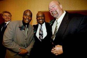 Joe Poplawski (back) looks on as (from left) Willard Reeves, Frank Robinson and Chris Walby pose for a picture prior to the Manitoba Sports Hall of Fame induction ceremony in November, 2010,  which included the1984 Winnipeg Blue Bombers team. The Bombers' 1988 roster — which Walby was also on — is being inducted into the Hall this year.