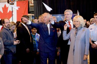 Charles, Prince of Wales, Prime Minister Stephen Harper and Camilla, Duchess of Cornwall fly paper airplanes as part of Aerospace and Aviation Day at Stevenson Hangar during the Royal Tour visit to Winnipeg May 21.