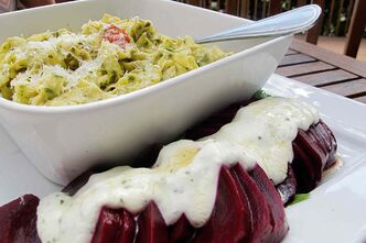 The basil pesto fettuccine and roasted beet salad at Chaise Café & Lounge.