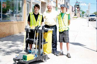 St. Johns MLA Gord Mackintosh welcomes this year's Green Team on Main Street: Shawn Huff (left) from West Kildonan Collegiate and Clark Northwood from St. John's High School.