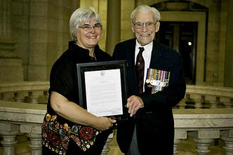 Riel MLA Christine Melnick welcomes the last surviving member of the Arden Seven, George Peterson, to the Manitoba Legislature.