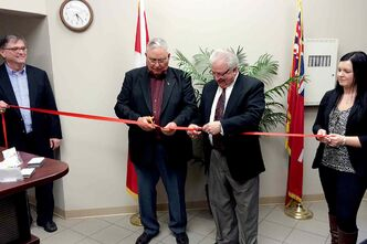 From left: Community Futures White Horse Plains (CFWHP) executive director Ken Keith, CFWHP past chair Bill Knight, St. Francois Xavier reeve and CFWHP chair Roger Poitras, and Robyn Bruneau, finance and administration, cut the ribbon at CFWHP's new office in Elie.
