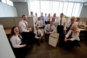 Movember Winnipeg co-chair Jamie Hopkins, centre, and co-workers at Manitoba Hydro are ready for Movember..