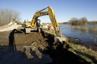 Crews work on the deliberate breach in the Assiniboine River dike at Hoop and Holler Bend.