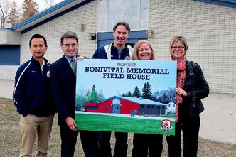 From left to right: Oai Truong, president of Bonivital Soccer; Brian Mayes, city councillor for St. Vital; Colin Ottenbreit, general manager of Bonivital Soccer; Sheila Cornick, vice-president of Bonivital Soccer; and Nancy Allen, MLA for St. Vital, show a mock-up for the Bonivital Memorial Field House.