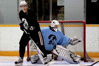 Raiders Jr. Hockey Club defenceman Jordan Lisowick and goaltender Brenden Fiebelkorn practise.