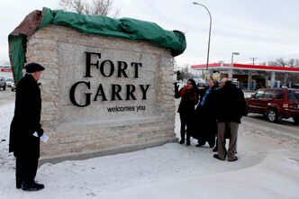 "Mayor Sam Katz, dignitaries and a handful of area residents braved the cold to attend the unveiling of the new ""Fort Garry welcomes you"" sign on Pembina Highway on Dec. 13."