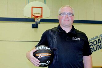 Principal Sparling gym teacher Timothy Strachan has been coaching with the Todd MacCulloch Hoop School for five years, teaching skills and teamwork.