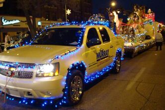 Murray Chevrolet vehicle pulls the sleigh in Santa Claus Parade.
