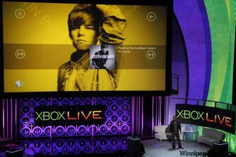 "Microsoft demonstrates its Xbox Live Kinect's voice feature, that can ""pause"" or ""play"" when watching a movie or song on the Xbox instead of reaching for the remote during the 2010 Xbox 360 media briefing at the Wiltern Theater, Monday, June 14, 2010, in Los Angeles."