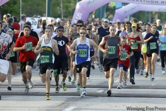 Manitoba Marathon Relay runners start their race this morning. The event began in 1979 and has record participation this year.