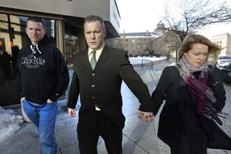 Winnipeg city police officer Peter O'Kane, (centre) leaves the Law Courts in February, 2011. Manitoba's highest court has ordered a new perjury trial against O'Kane and another officer, Jess Zebrun.