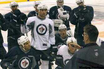 Winnipeg Jets coach Claude Noel talks to the troops during the morning skate at the MTS Centre.