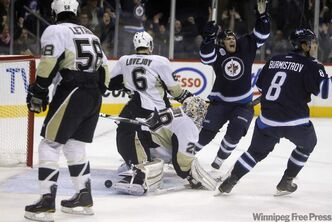 Jim Slater and Alexander Burmistrov celebrate the Jets second goal.