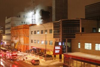Firefighters work to contain a fire late Tuesday night in a wing of Health Sciences Centre currently under construction