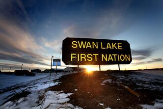 The sun sets in the south western sky just behind the Swan Lake sign, which is symbolic of the many positive changes happening on this reserve.