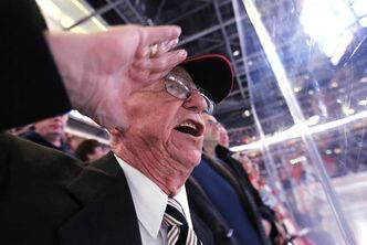 Second World War veteran Len Kropioski salutes and sings at Monday's game.