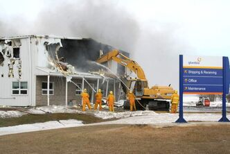 Volunteer firefighters from Angusville, Russell, Rossburn, Birtle and Shoal Lake work to douse a fire at the flaxseed plant near Angusville in March. The company announced today it would rebuild the plant in Sioux Falls, S.D.