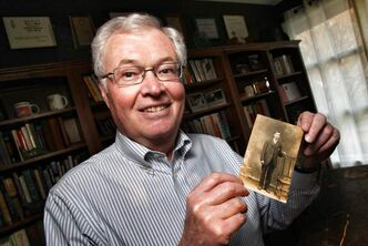Winnipeg Foundation CEO Rick Frost with a photo of his grandfather, who was sent to Canada at age 12.