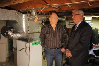 Home owner Bert Heinrichs  (left) talks with Manitoba Premier Greg Selinger.