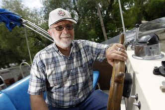 Bob Baranoski, commodore of the Royal Manitoba Yacht Club, prepares his boat, Knight Shift, for Sunday's flotilla to mark the Queen's Diamond Jubilee.