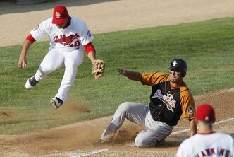 Winnipeg Goldeyes' Amos Ramon does his best to avoid the Sioux Falls runner at third base Saturday.