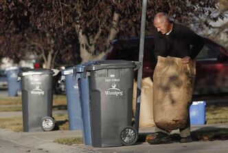 Residents of Baisinger Drive put out their garbage last week.