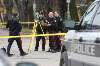 Police investigate the scene of a serious pedestrian accident on Salter Street at Alfred Avenue Saturday morning.