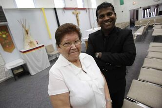 'Kateri is not just for Winnipeg and for Canada,' says Rev. Sebastian Maria Susairaj, who has served the only aboriginal Catholic parish in Winnipeg for four years. Next to him is Ojibwa parishioner Elsie Moar.