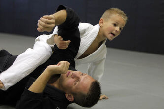 Logan Sawatzky, 5, grapples with his dad, blackbelt John Sawatzky at a special bullying class in Steinbach, Manitoba.