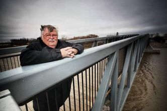 Riverton Mayor Colin Bjarnason stands on the new footbridge that crosses the Icelandic River.