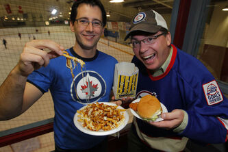 Chris Carman and Chris Zuk at Notre Dame Community Club with some Canteen food. Poutine, Popcorn, and a real chicken burger.