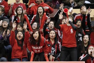 Sisler Spartans fans explode with glee as their boys' basketball team scores on the Kelvin Clippers in a AAAA high school semi-final on Friday night.