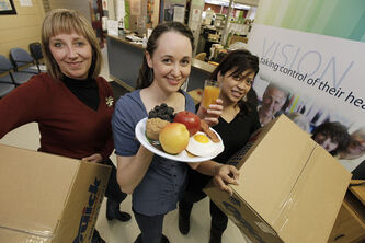 From left, Michelle Kirkbride, Community Development Co-ordintor with NorWest Co-op, Kristina McMillan, Community Food Centre Director, and Marsha Gravador, Primary Care Assistant with NorWest Co-op with moving boxes in what is to become the NorWest Community Food Centre (CFC)