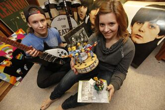 Victoria Ploszay and her brother, Paul, with their Beatles souvenirs.