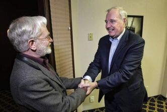 Former prime minister Paul Martin (right) greets Manitoba Education deputy minister Gerald Farthing prior to a private dinner in Russell on Tuesday.